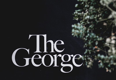 The George Hotel Hamburg logo